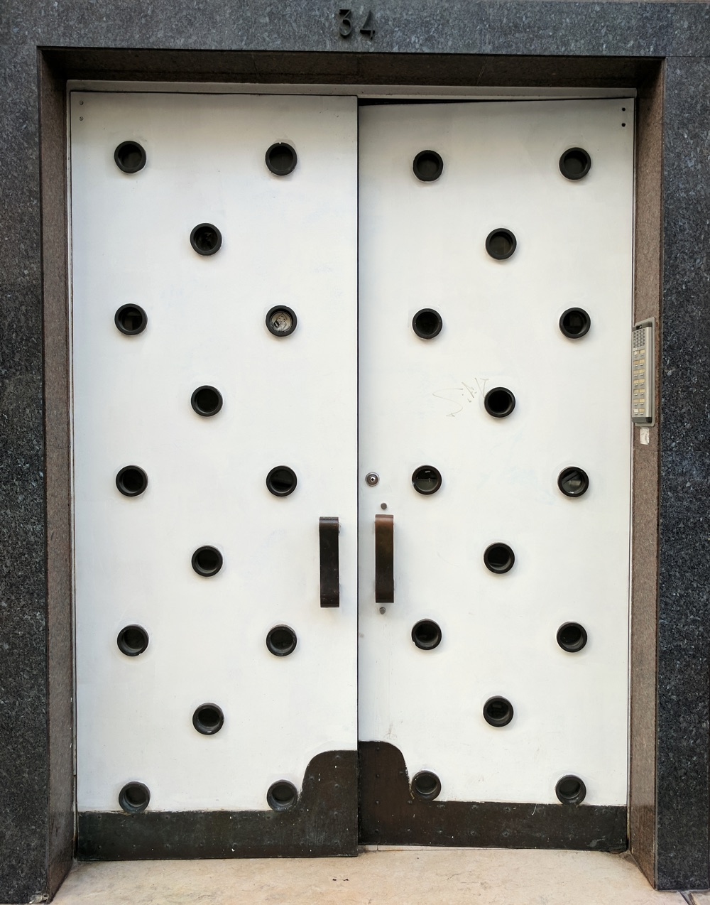 white door with black polka dots