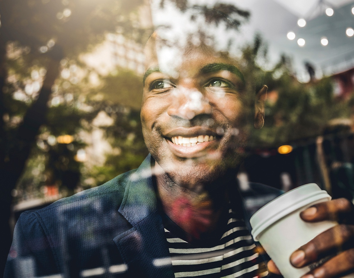 Man smiling through a window